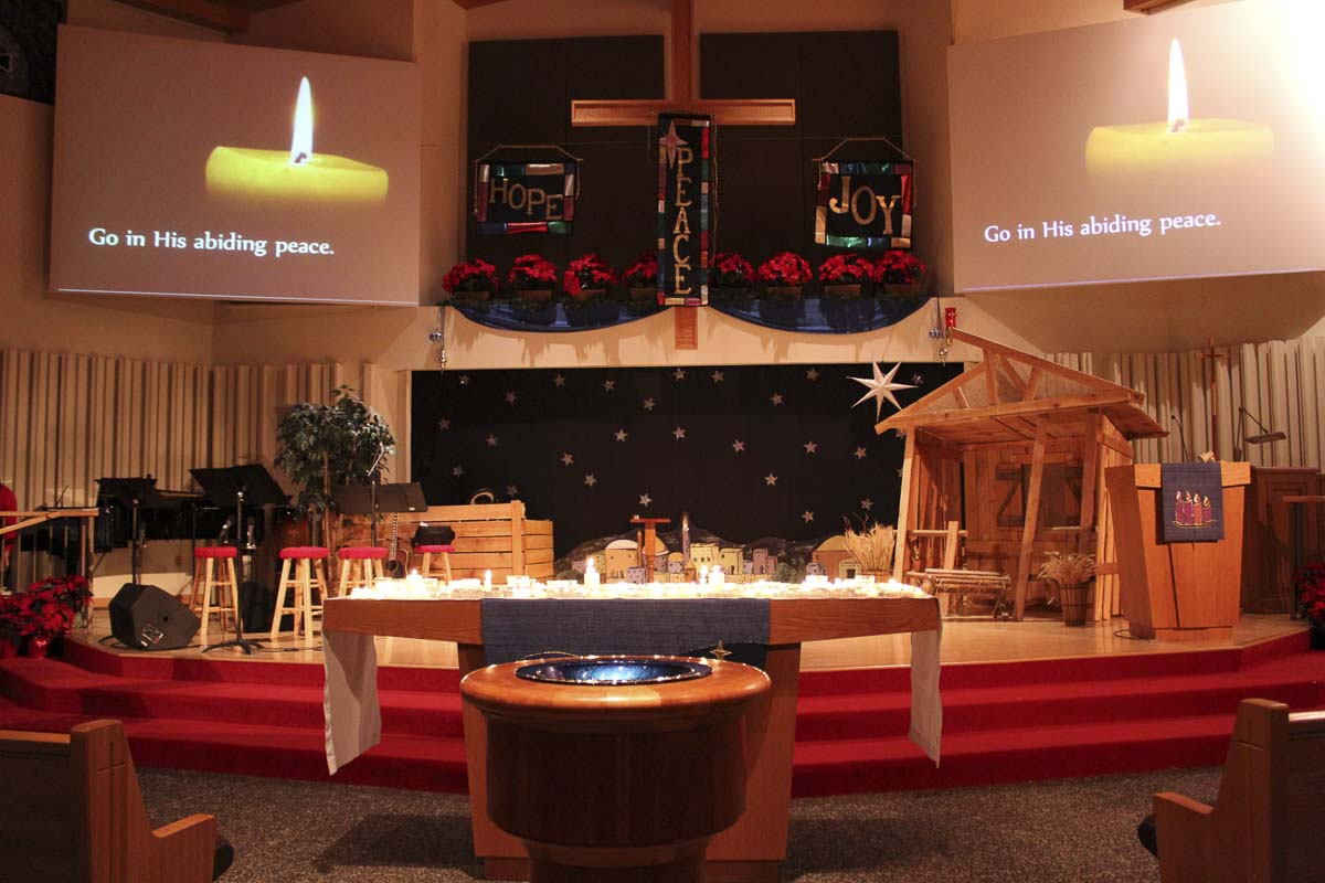 The sanctuary is dimly lit for the Longest Night Service and people feel comfortable to cry if they want. Photo courtesy of Diane Stevens