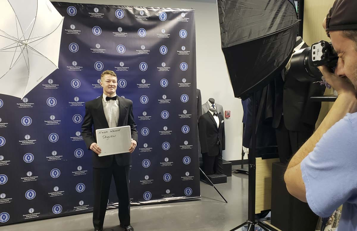 Skyview's Mason Wheeler has his photo taken after he had his tuxedo fitted in preparation for the Clark County chapter of the National Football Foundation's annual banquet. The banquet, Jan. 15 at Hudson's Bay High School, recognizes more than 30 senior football players who excel on the field, the classroom, and in the community. Photo by Paul Valencia
