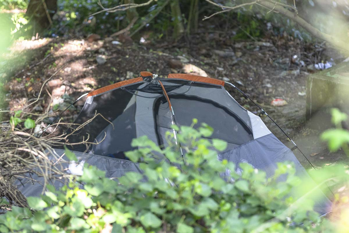 A tent marks a homeless encampment in a wooded area along Grand Boulevard south of the Vancouver Navigation Center. Photo by Mike Schultz