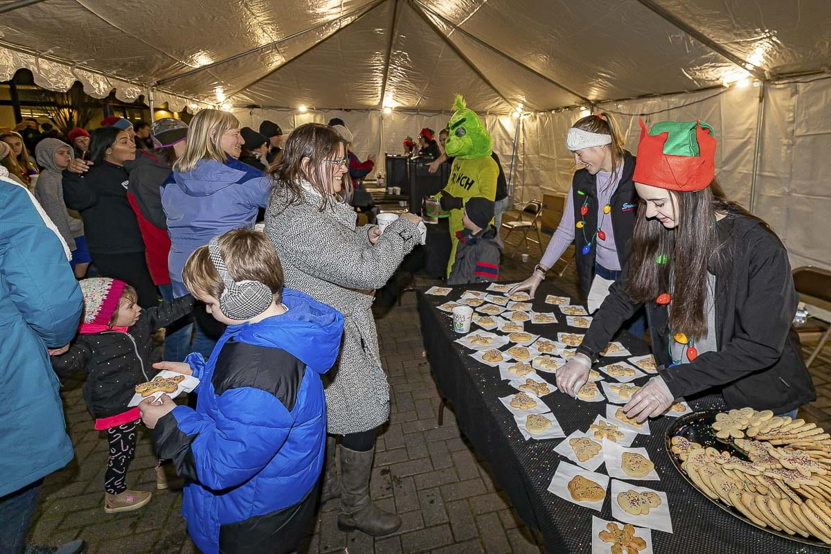 Parade goers receive free cookies and hot cocoa during Washougal's annual Holiday Parade and Tree Lighting. Photo by Mike Schultz