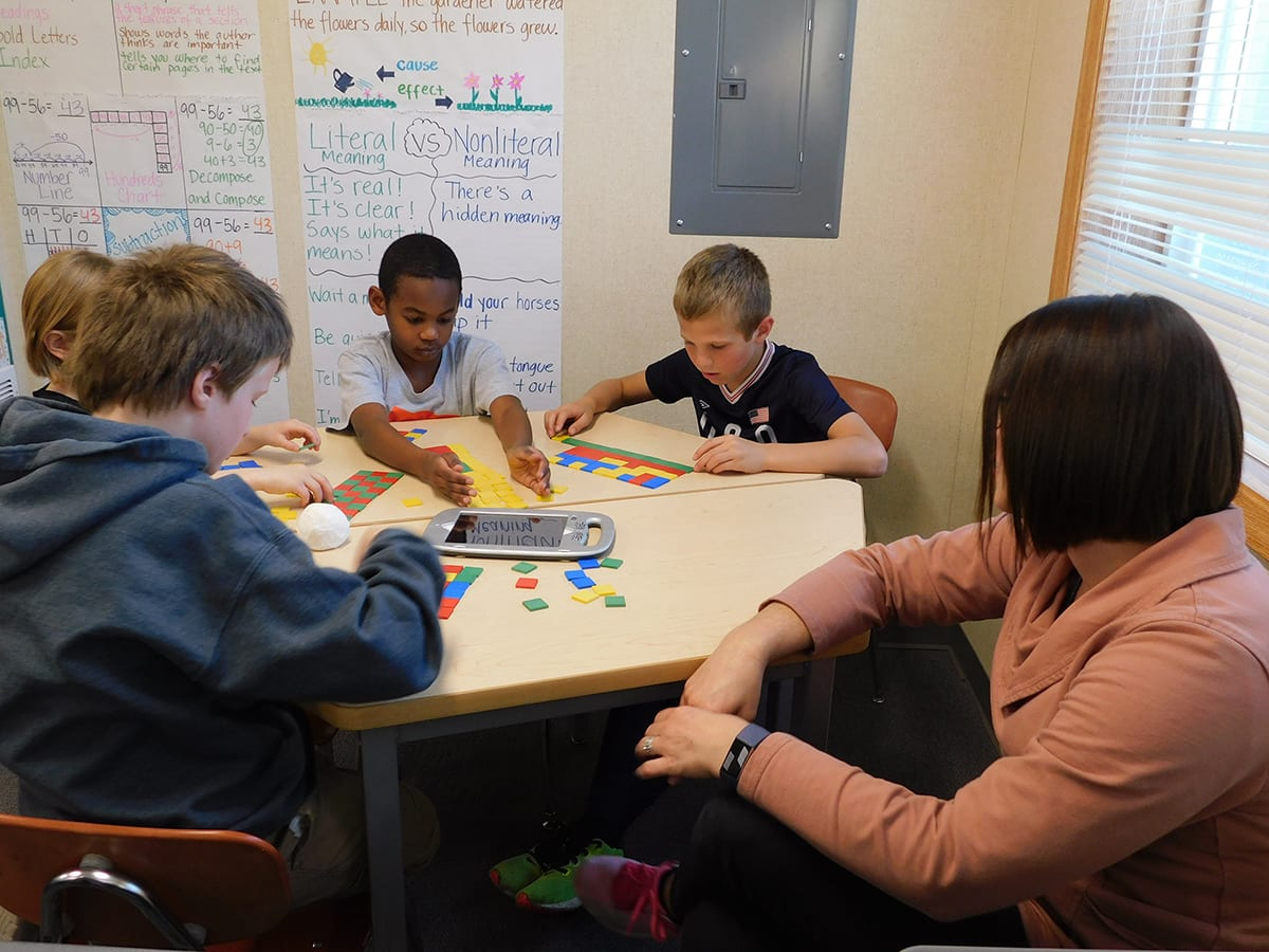 At her co-teaching station, South Ridge Elementary School teacher, Megan Suarez works with a group of students using colored squares to visualize multiplication. Photo courtesy of Ridgefield Public Schools