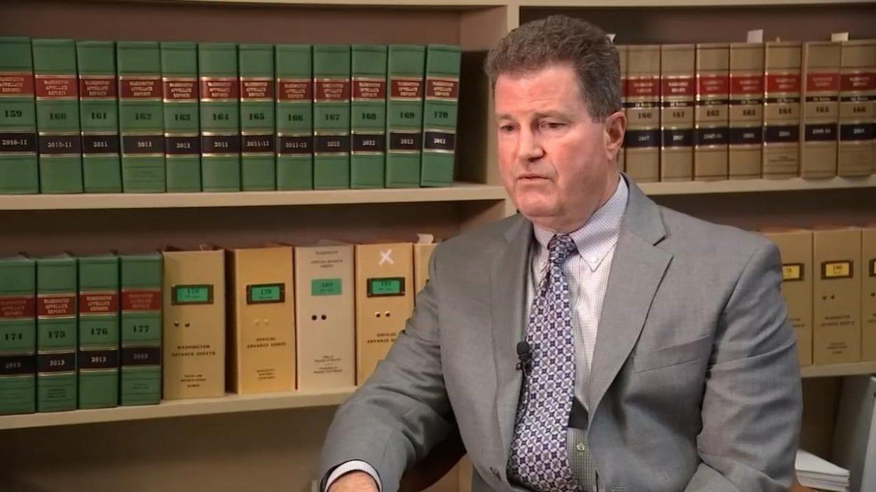 Clark County Superior Court Judge John Fairgrieve speaks with KPTV reporter Kelsey Watts. Photo courtesy KPTV FOX 12