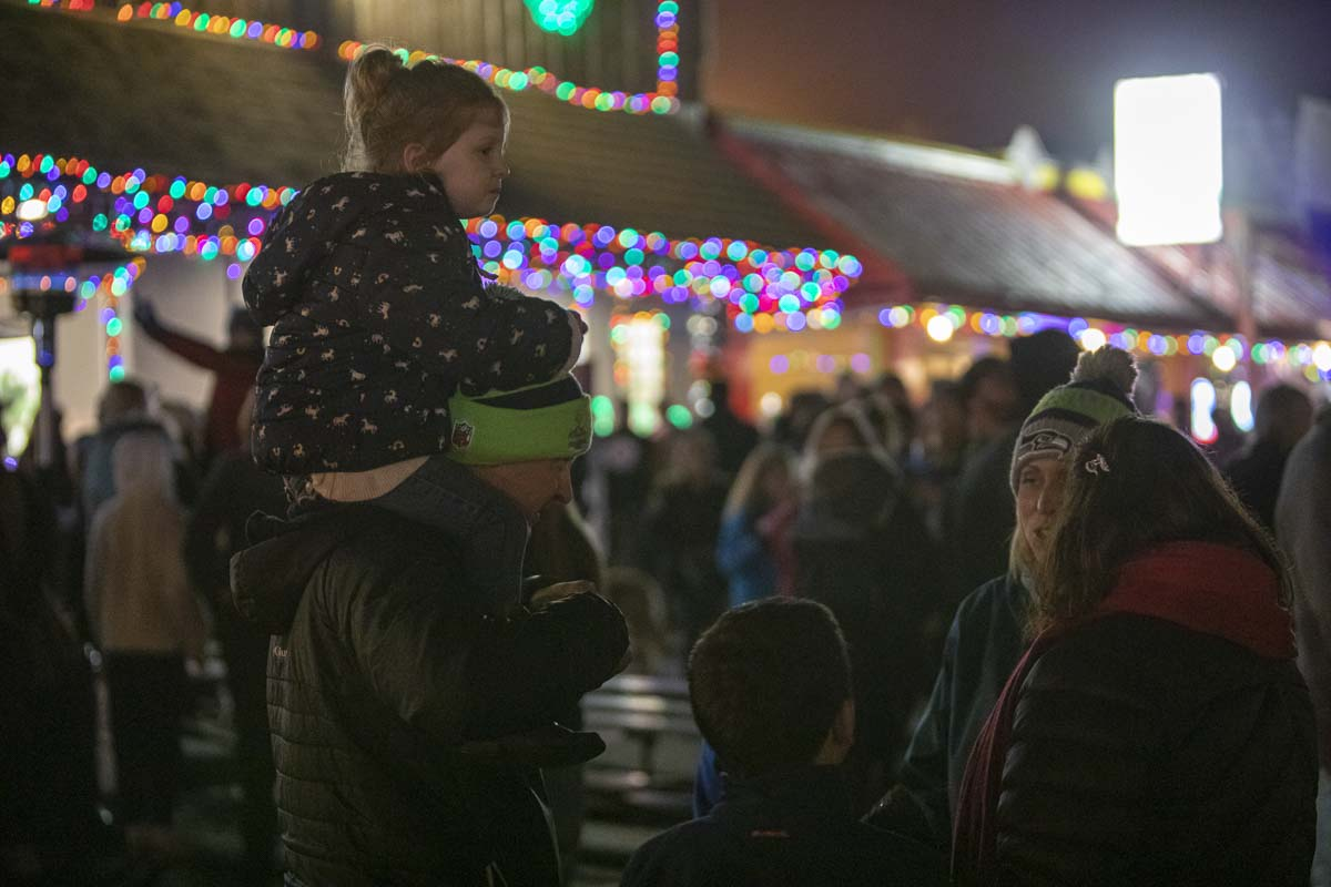 Brian Logan holds his daughter Evelyn on his shoulders during the 2019 La Center Christmas Festival. Photo by Jacob Granneman
