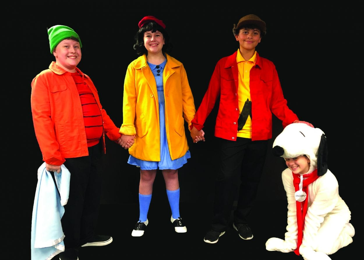 From left to right, actor Emerson Skogen as Linus, actress Norah Skogen as Lucy, actor Jaedon Moore as Charlie Brown, and actress Caroline Gienapp as Snoopy. Photo courtesy of Metropolitan Performing Arts