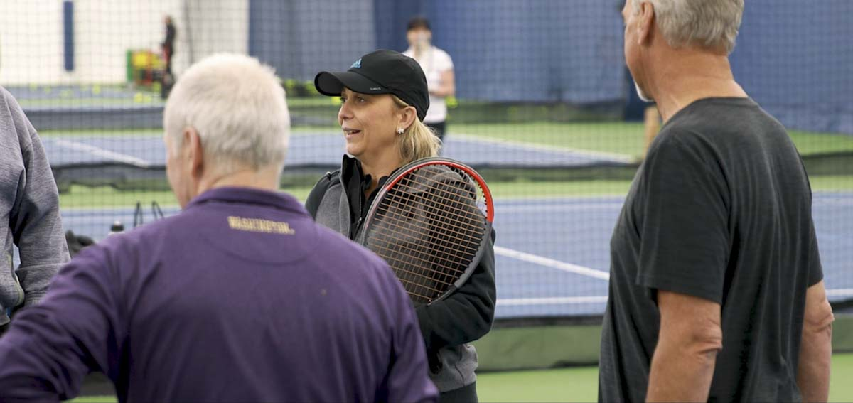 Sanja Lemes (center) talks to her tennis class at the Vancouver Tennis Center. The group has been together for over 10 years. Photo by Jacob Granneman