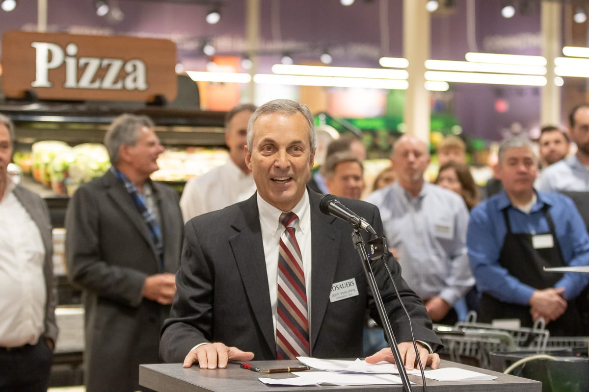 Rosauers President and CEO Jeff Philipps addresses a crowd before the grand opening of the Ridgefield Rosauers Supermarket on Saturday. Photo by Mike Schultz
