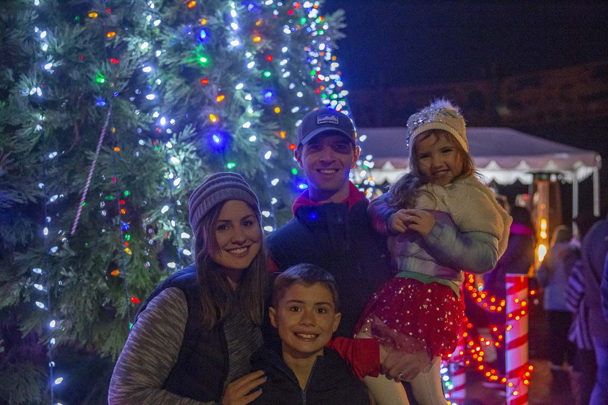 Bryan Rhoads (center) and his wife Erica (left) pose for a photo at the annual Ridgefield Christmas tree lighting with their two children, Tenley (right) and Tristan (lower left). Photo by Bailey Granneman