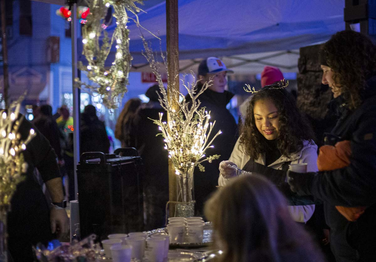 Maura Martin helps serve hot chocolate and marshmallows at the Hometown Celebration and tree lighting in Ridgefield. Photo by Bailey Granneman