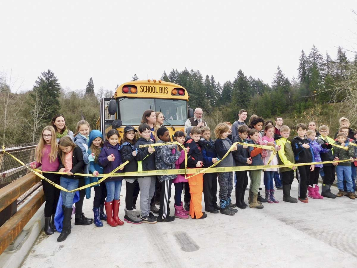 Students from South Ridge Elementary and Ridgefield High School cut the ribbon for the new bridge. Photo courtesy of Ridgefield Public Schools