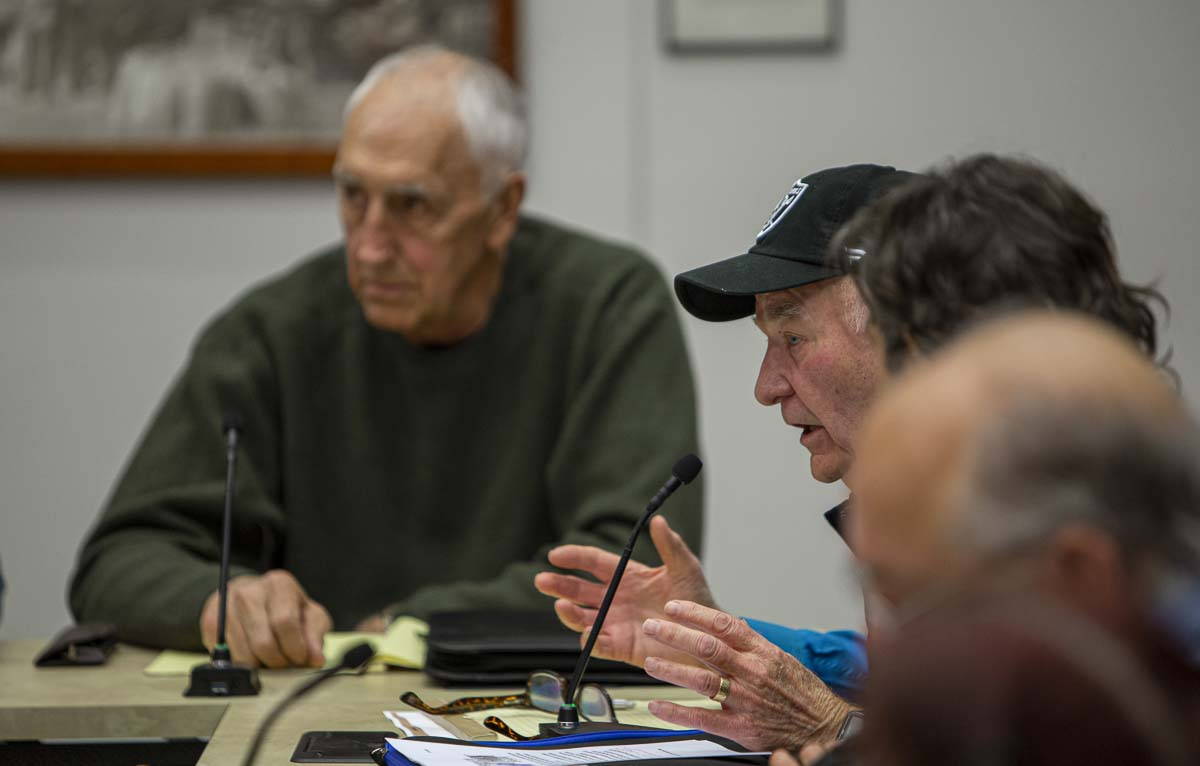 Yacolt Mountain neighbor Richard Dyrland (right) speaks to the committee during the SMAC meeting on Dec. 19. Photo by Jacob Granneman