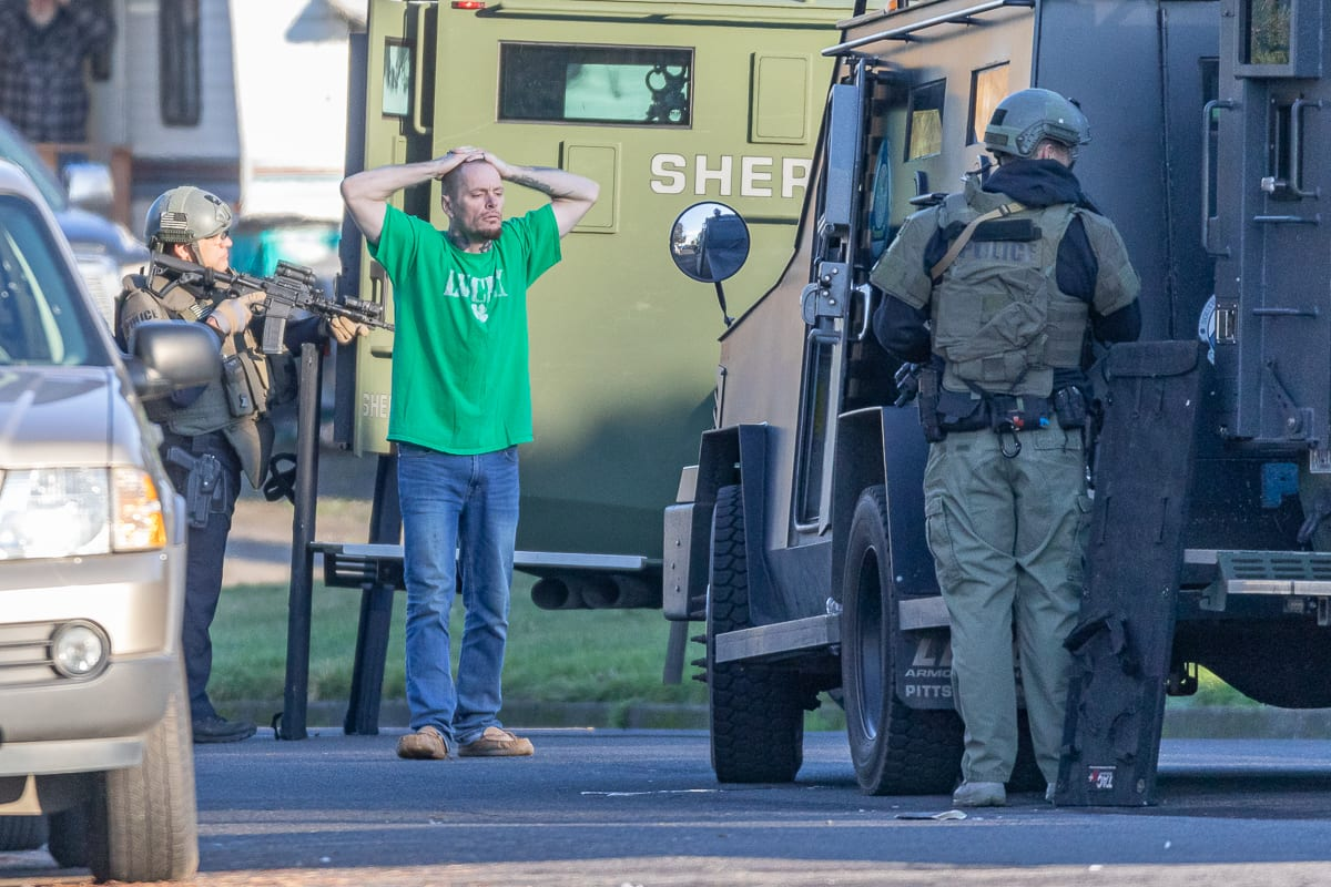 Lynn Cargile is taken into custody after a standoff with SWAT team members.