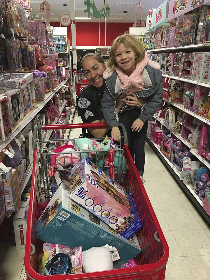 Sgt. Holly Musser and her young shopper appear to be making a lot of process at Saturday's Shop With a Cop event in east Vancouver. Photo courtesy of Vancouver Police Department