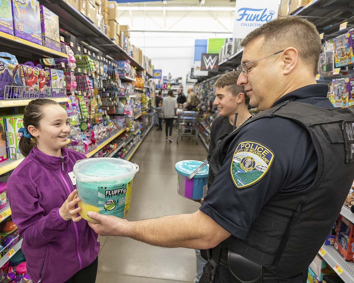 Woodland Police Officer Brent Murray shops with children at the 2019 Shop with a Cop in Woodland. Photo by Mike Schultz