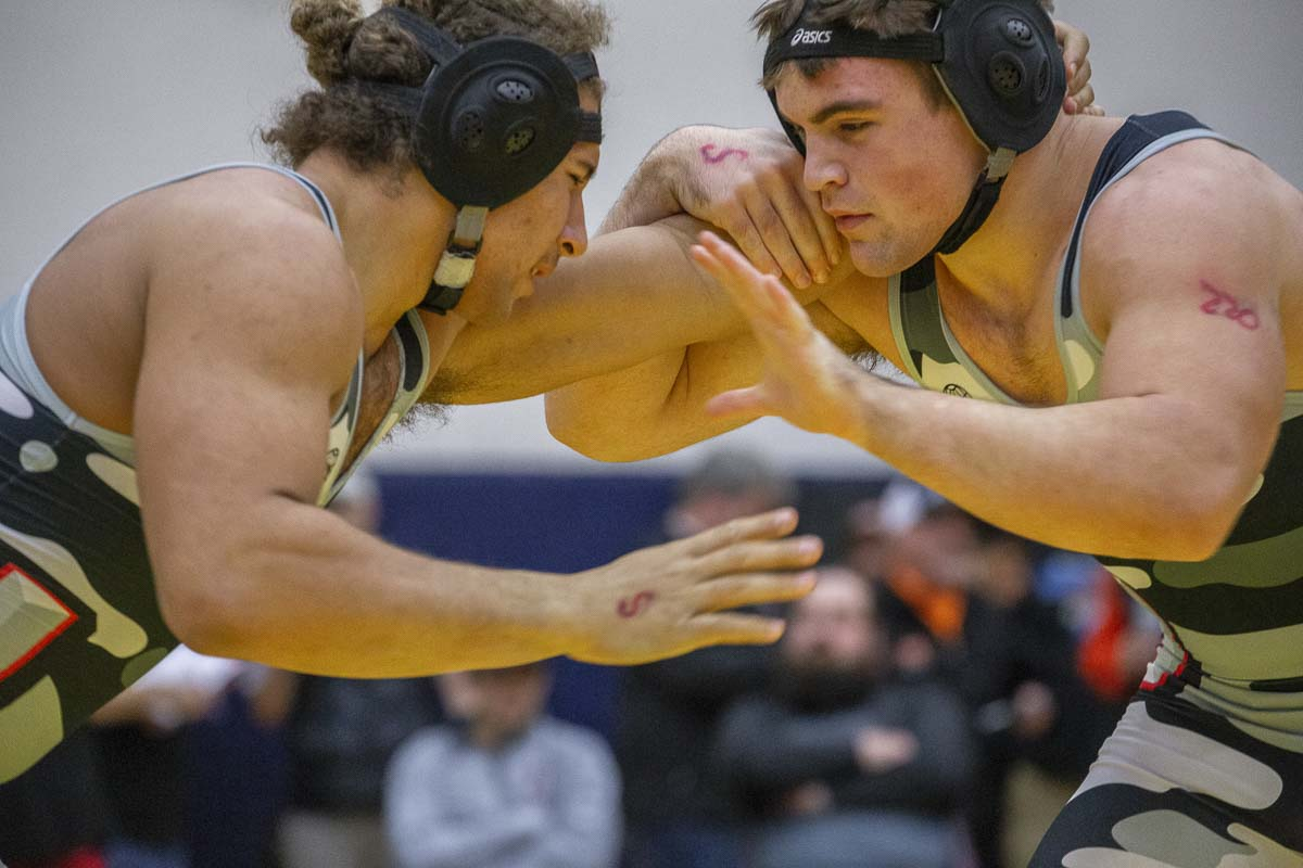 Levi Harms (right) said it was a win-win to wrestle a teammate in the finals of the Clark County Championships. Harms defeated Logan Wilson, and the Union Titans won the boys team title, too. Photo by Jacob Granneman