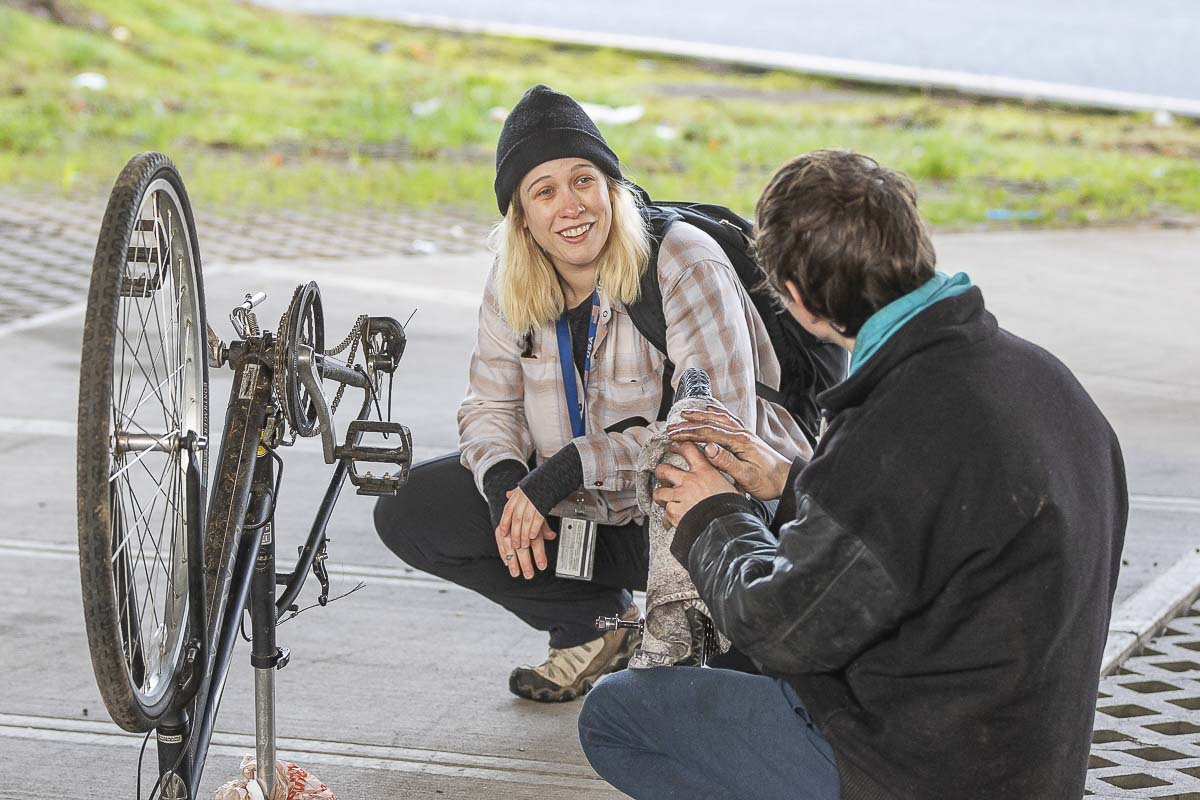 Ashley Gaffney, outreach case manager for Share, speaks with a homeless man during the annual Point in Time count on Thursday. Photo by Mike Schultz