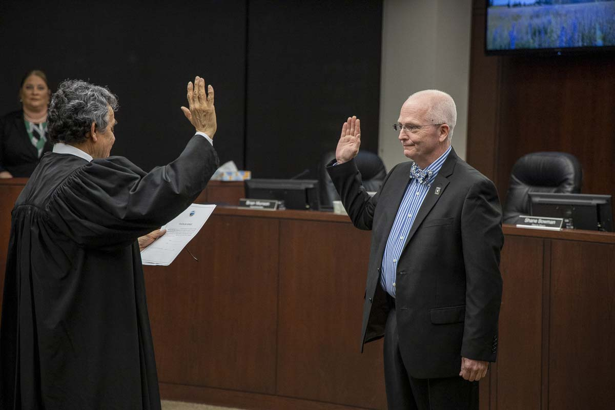 Third-term city councilor Philip Johnson is sworn in for the second time as deputy mayor of Battle Ground during a ceremony Monday night. Photo by Chris Brown