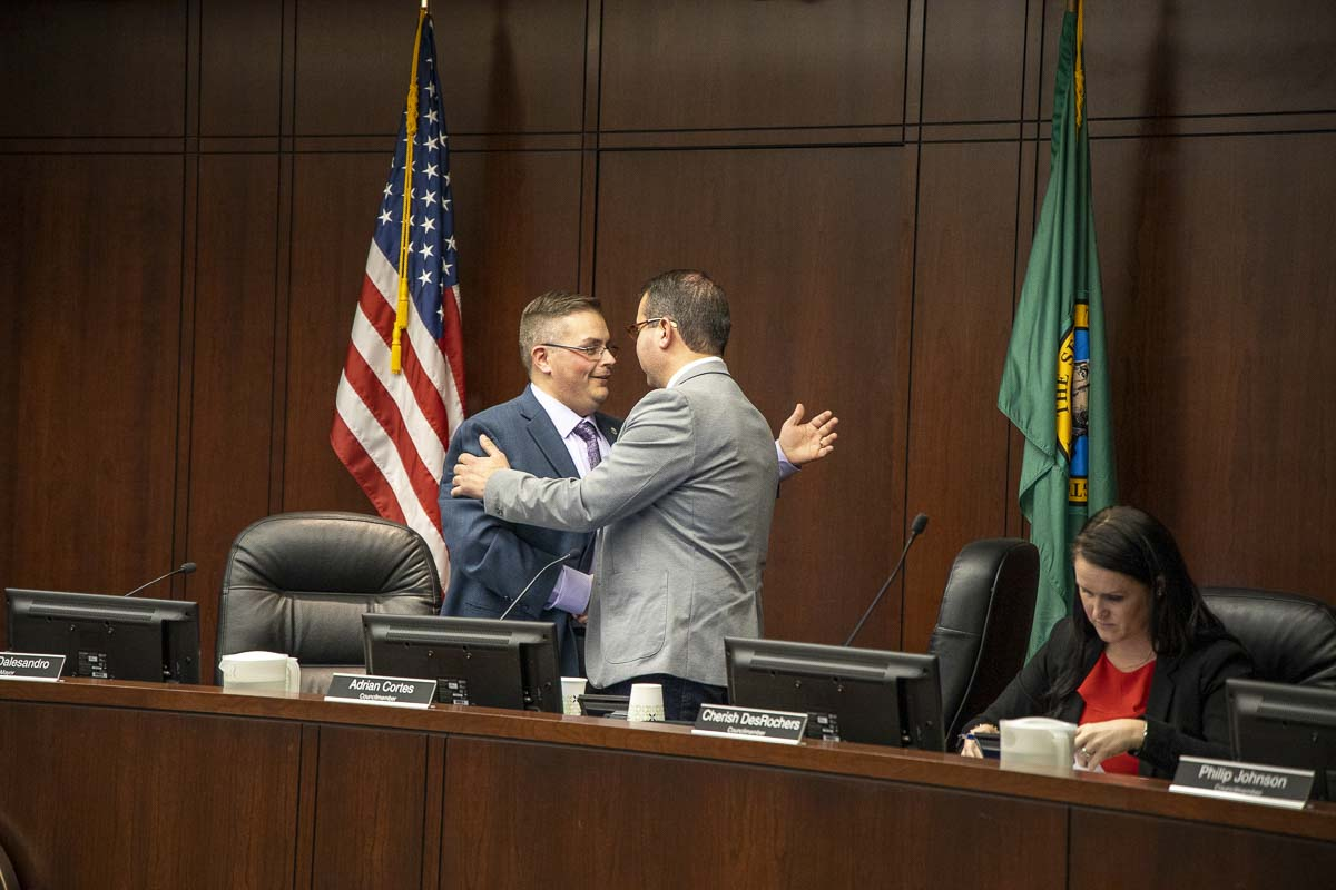 Outgoing Mayor Mike Dalesandro congratulates Adrian Cortes after he is named new mayor of Battle Ground on Monday night. Photo by Chris Brown