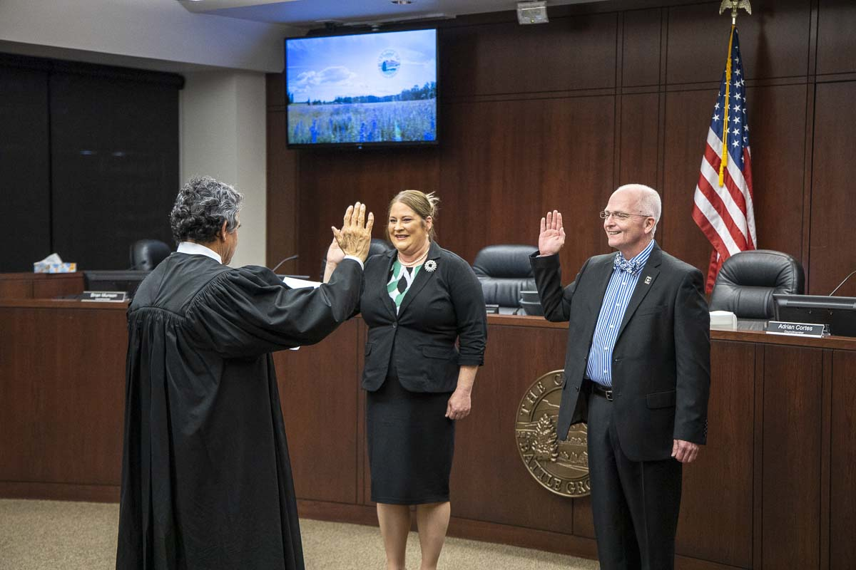 New Battle Ground City Councilor Shauna Walters takes the oath of office Monday night, along with Councilor Philip Johnson, who was re-elected in November. Photo by Chris Brown