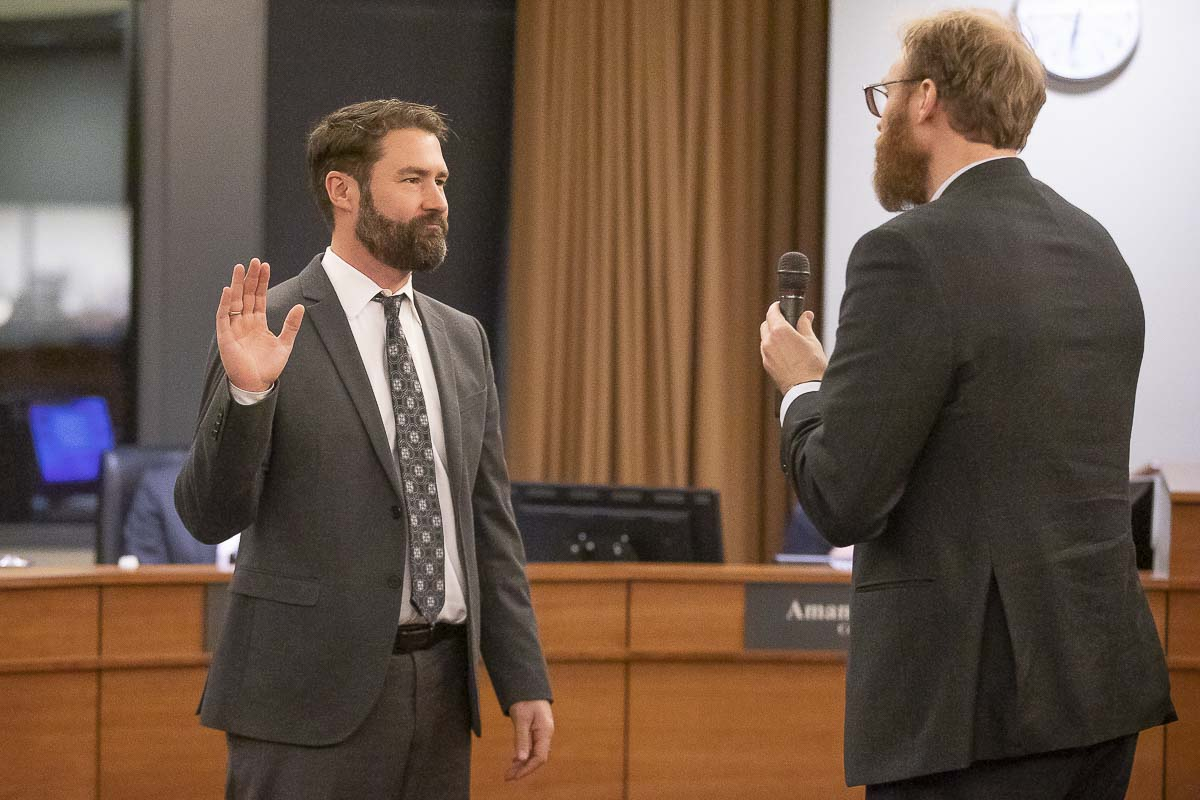 Vancouver City Councilor Bart Hansen takes the oath of office after winning reelection in November. Photo by Mike Schultz