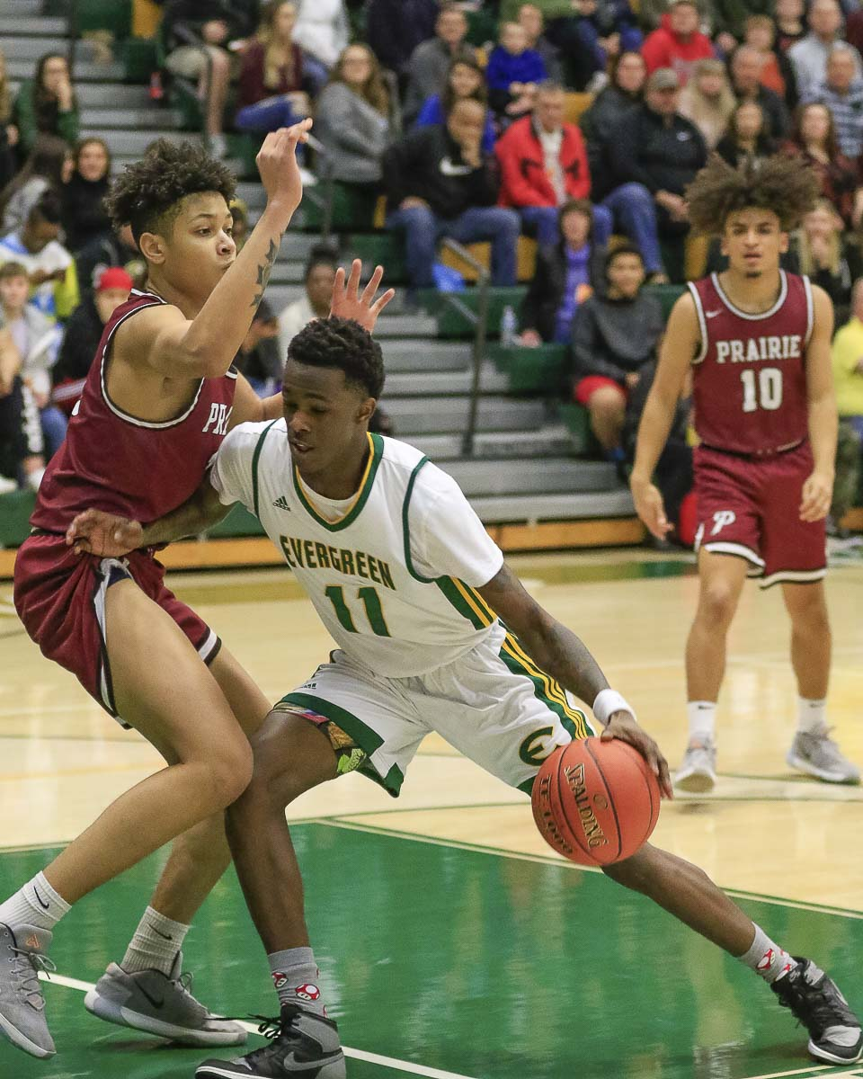 Evergreen's Mario Herring had 13 points, plus he played solid defense, in a win over Prairie. Photo by Mike Schultz