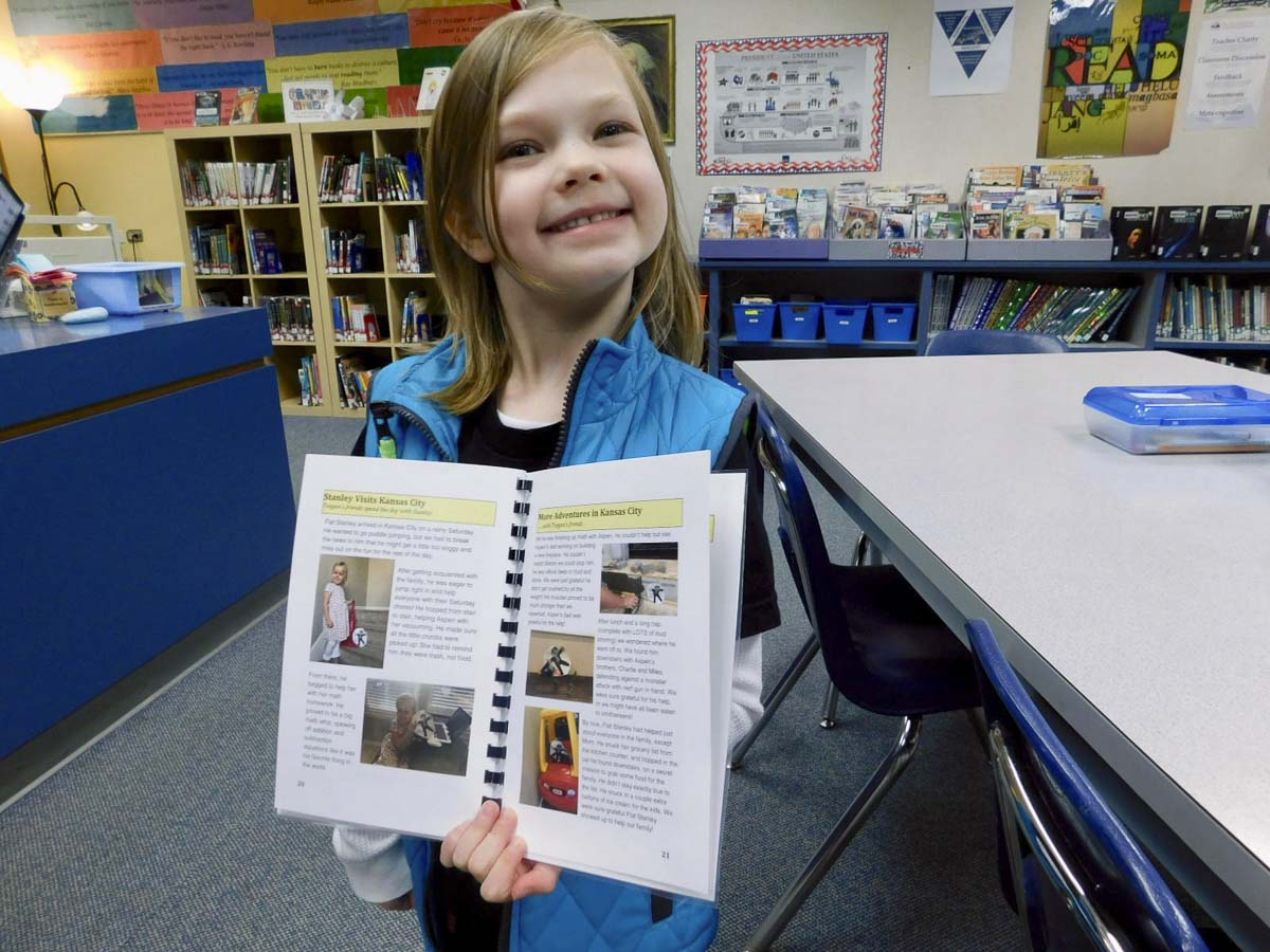 South Ridge Elementary School first grader, Teegan Thompson, proudly shares her Flat Stanley pages. Photo courtesy of Ridgefield School District