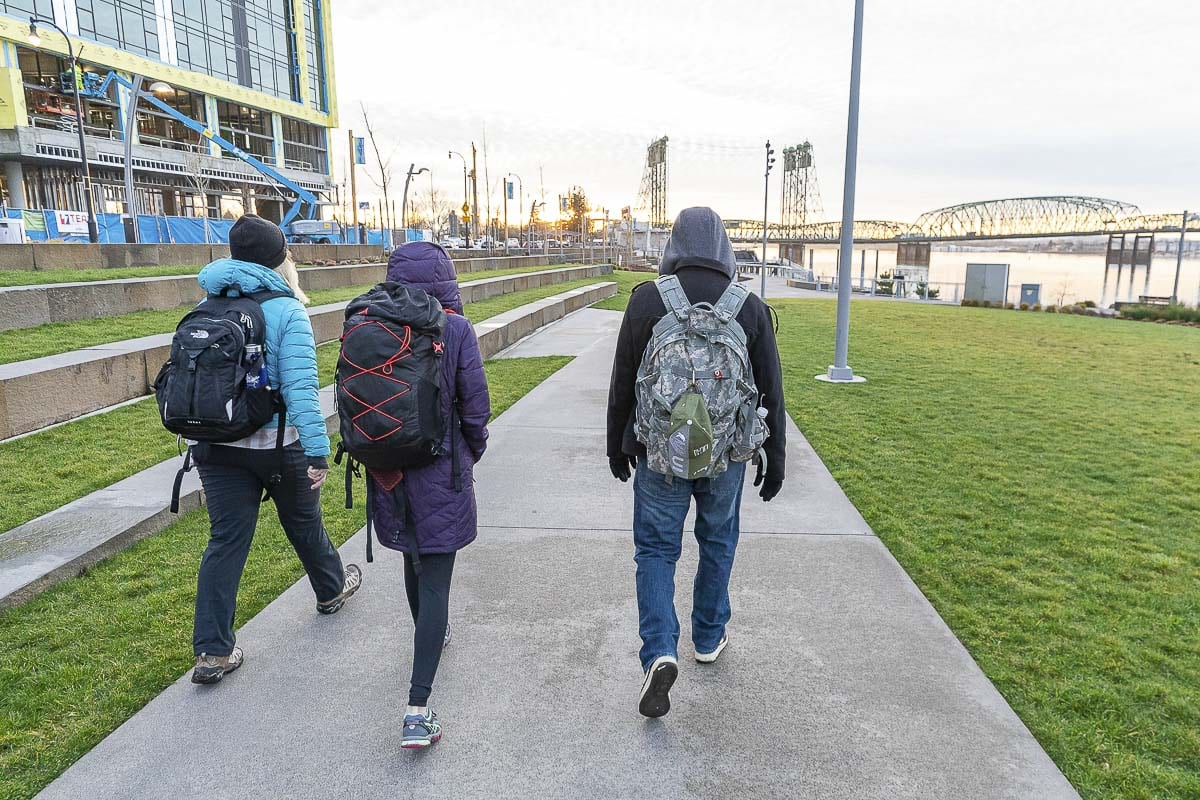 Ashley Gaffney, Sara De La Torre, and Brian Coleman walk along the Vancouver Waterfront during the annual Homeless Point in Time count on Thursday. Photo by Mike Schultz