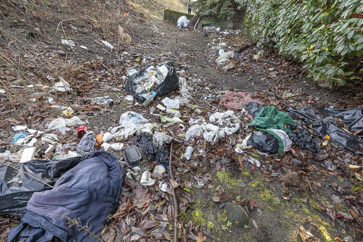 Garbage, including drug paraphernalia, is left behind at a homeless encampment along Columbia Way in Vancouver. Photo by Mike Schultz