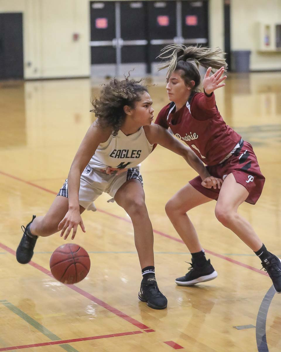 Dayna Vera, right, has always been strong on defense for the Prairie Falcons. Here, she is defending against Jaydia Martin of Hudson's Bay on Tuesday. Vera also scored 11 points in Prairie's victory. Photo by Mike Schultz