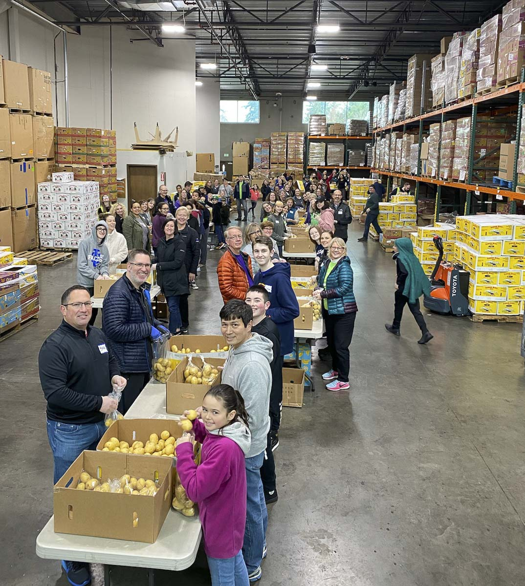 Kaiser Permanente employees sort 20 tons of potatoes at the Clark County Food Bank for MLK Day. Photo courtesy of Kaiser Permanente Northwest