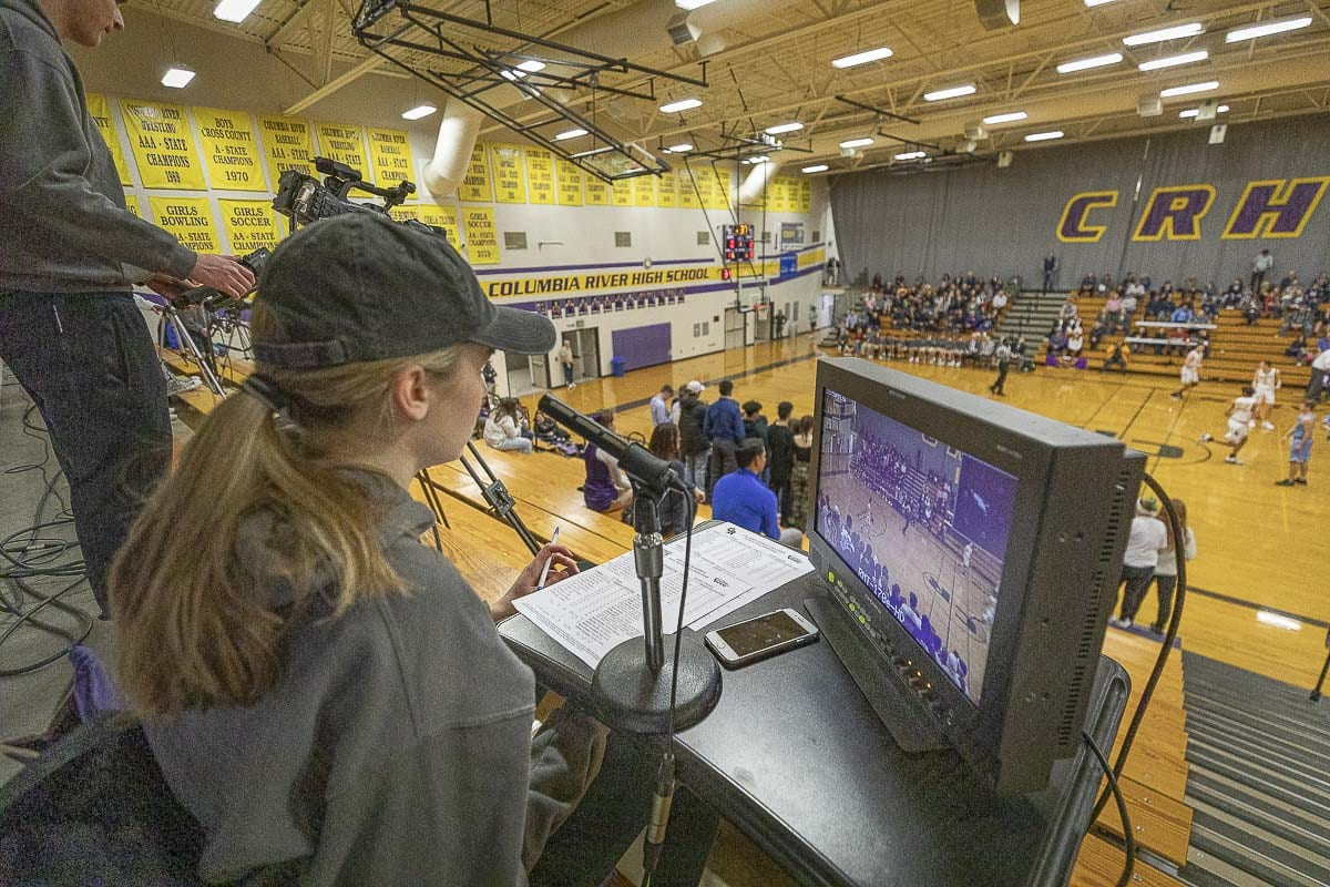 A quality broadcaster gets to a game early to prepare, so she is ready for the action. For Jordan Ryan, that means going to school at Columbia River, going to basketball practice, then rushing home and back to the school in time for her television gig. Photo by Mike Schultz