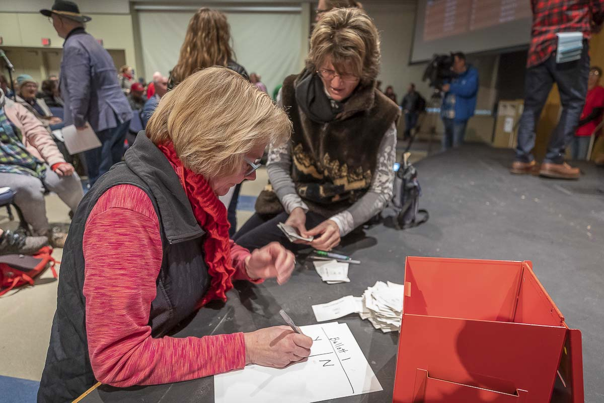 Julie Lemmond and Patricia Atkinson tally votes at Gaiser Hall after union members voted to approve a new contract Wednesday. Photo by Mike Schultz