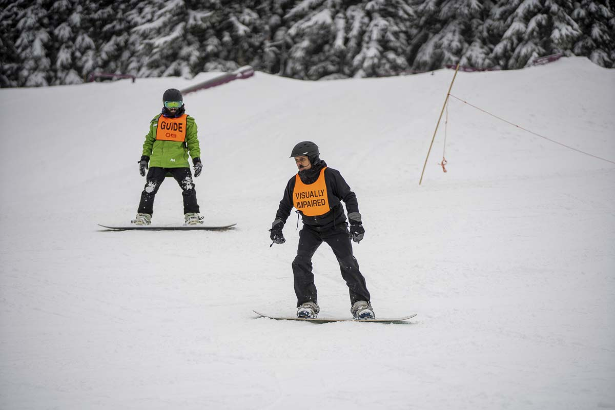 NWABA's skiing and snowboarding events will take place from 5:30–7:30 p.m. on Wed., Feb. 19 and Wed., Feb. 26. Anyone who is blind or visually impaired is encouraged to join in this opportunity to learn basic fundamentals and skills to participate in skiing and snowboarding. Photo courtesy of Kellen Ainley