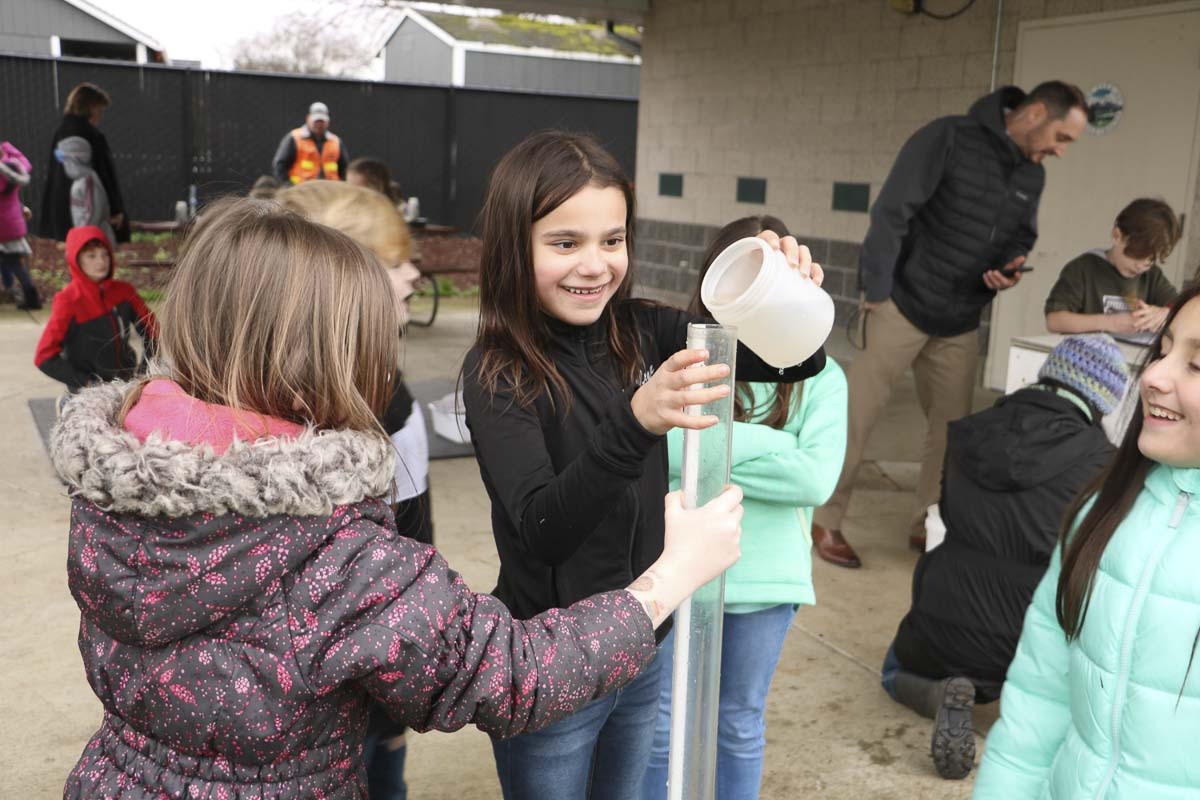 Maple Grove students collect and analyze water samples. Photo courtesy of Battle Ground Public Schools