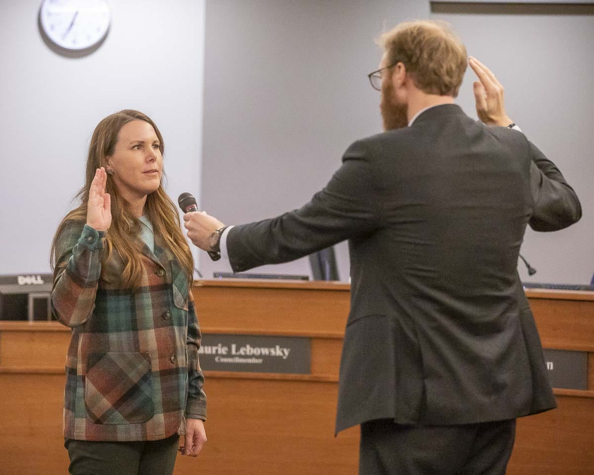 Sarah Fox takes the oath of office for Vancouver City Council, given by City Attorney Jonathan Young. Photo by Mike Schultz