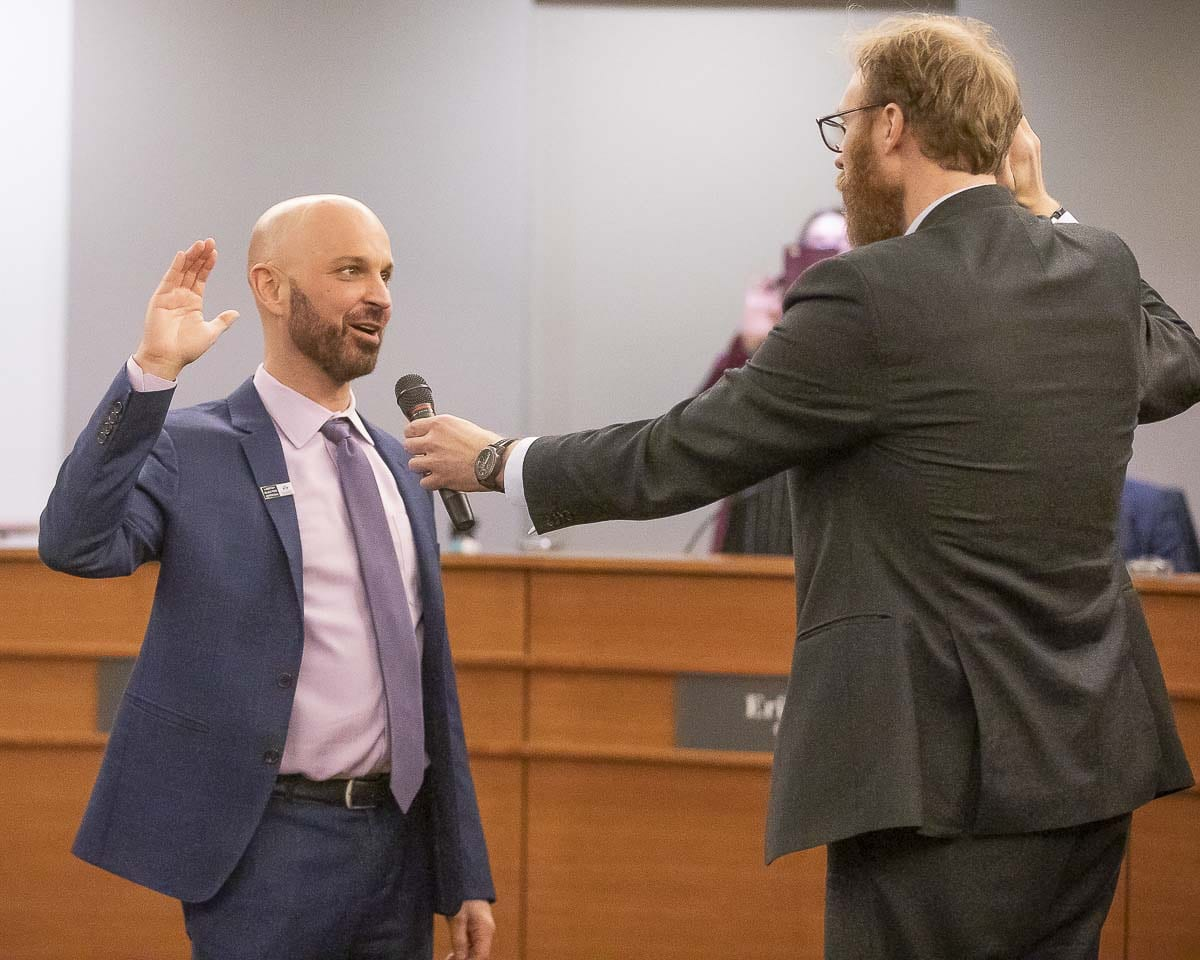 Vancouver City Councilor Ty Stober takes the oath of office after winning reelection in November. Photo by Mike Schultz