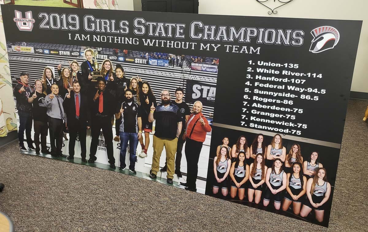 This large poster was delivered to Union High School this week and soon will be placed inside the school gym. State championships last forever. Photo by Paul Valencia