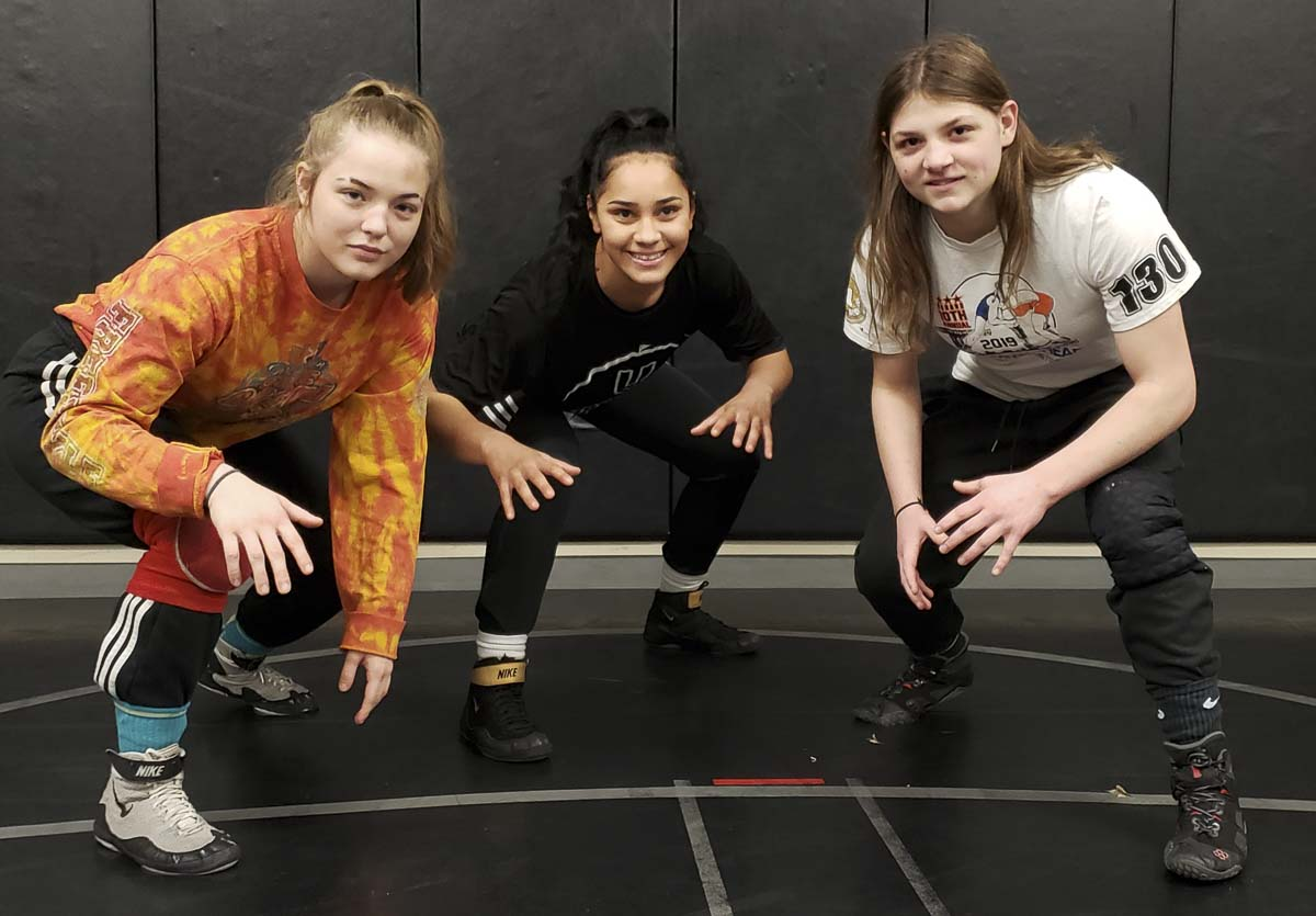 Nevaeh Cassidy (left), Alejandra Ayers (center) and Riley Aamold are three of the team leaders for the Union girls wrestling team. The Titans won the state team title last year, and are enjoying life as defending champions this season. Photo by Paul Valencia
