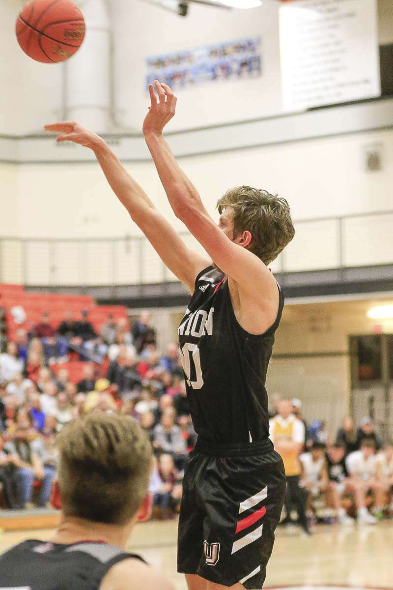 Mason Hill went off Tuesday night, making six 3-pointers, including four in the fourth quarter, helping the Union Titans rally to a win over Battle Ground. Photo by Mike Schultz
