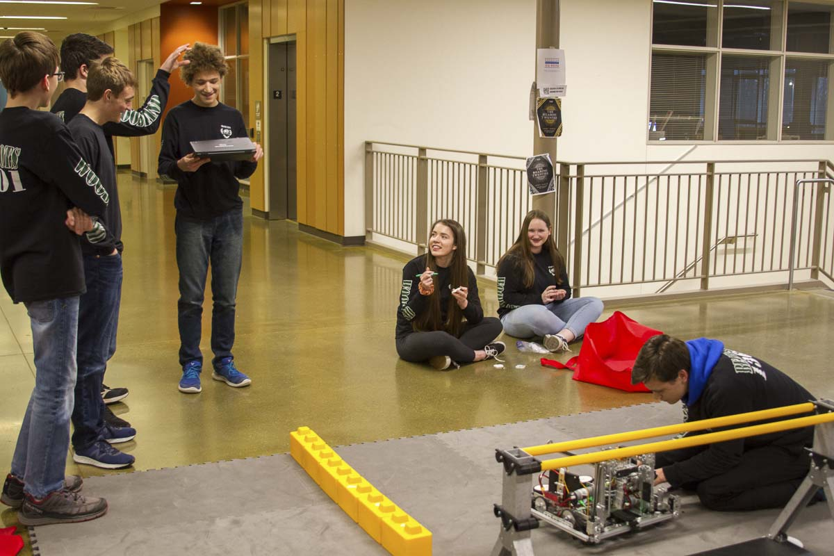 Programmers, builders, and project managers work closely together to create, program, and document a successful robot. Photo courtesy of Woodland Public Schools