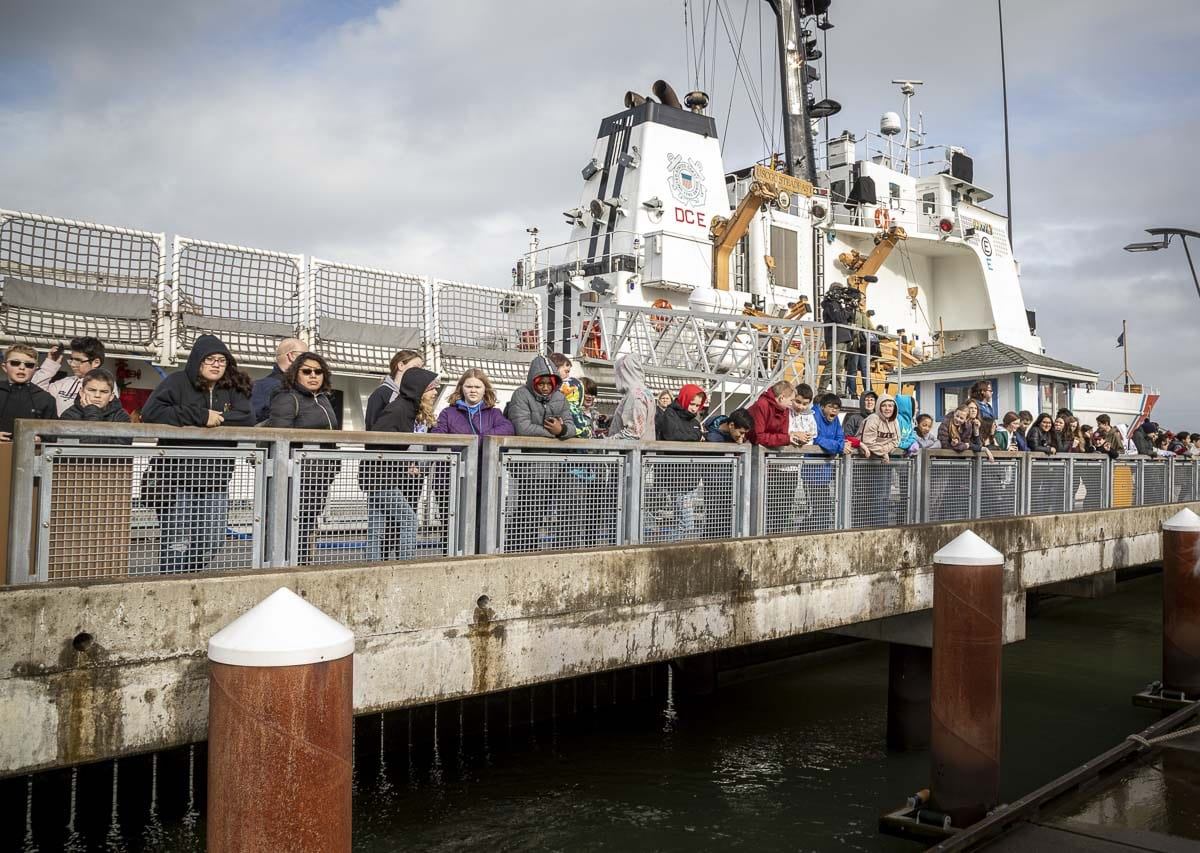 "Students from Wy'east Middle School in Vancouver line the dock in Astoria, Ore. waiting for the launch of their mini-boat, ""Liberty."" Photo by Jacob Granneman"