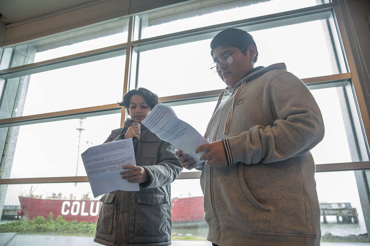 Wy'east students, Xavier and Angel, give an address about the meaning behind the name of their boat, which was named for the Liberty Ships of WWII. Photo by Jacob Granneman