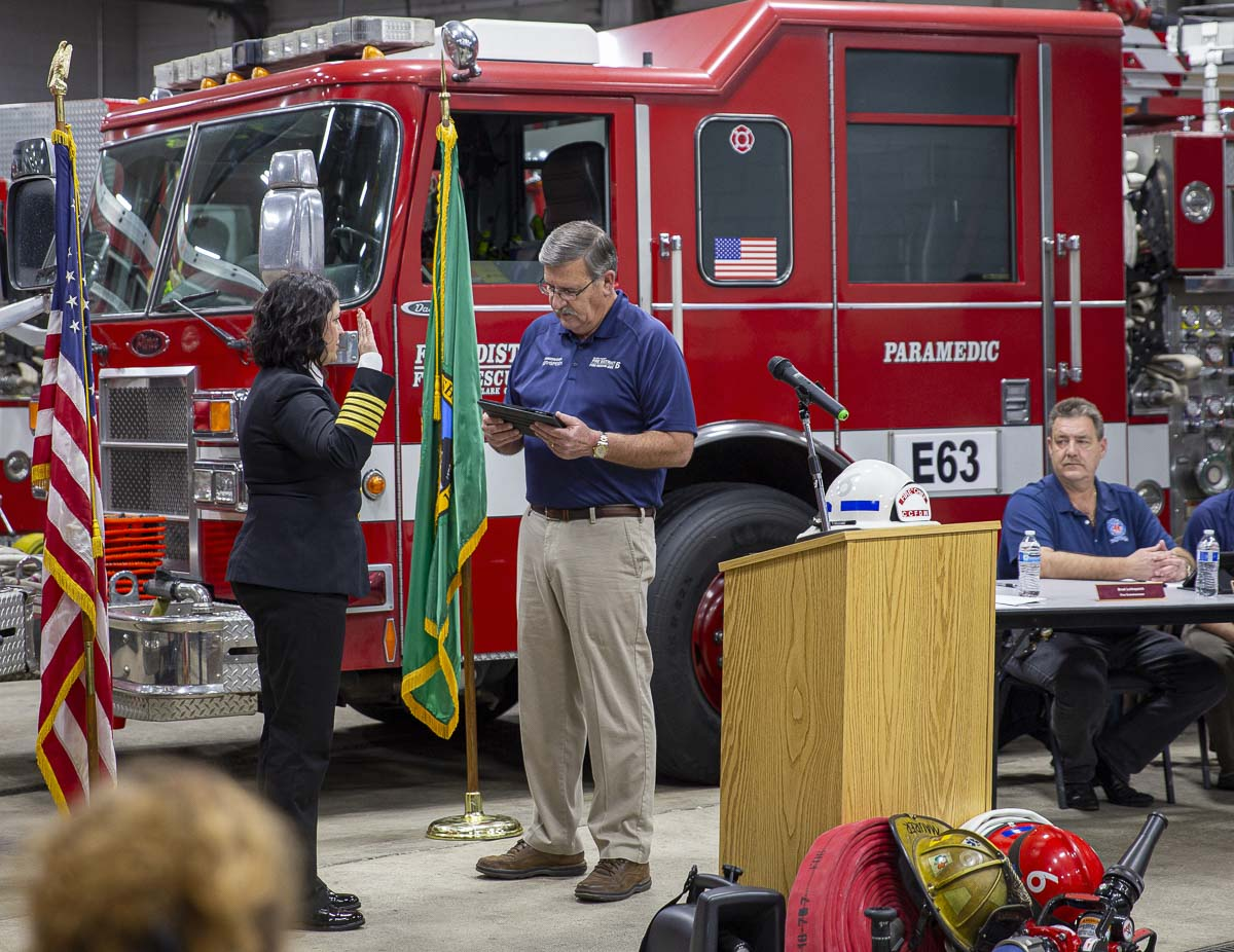 Clark County Fire District 6 Fire Chief Kristan Maurer (left) is shown here taking the oath of office from Fire Commissioner Brad Lothspeich (right). Photo by Jacob Granneman