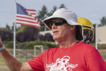 Neil Lomax gives advice as he exits Fort Vancouver football