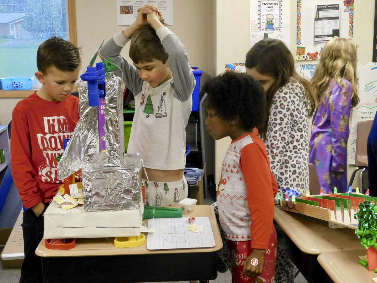 Union Ridge Elementary students watch a ball roll through a maze made of recycled tubes and boxes. Photo courtesy of Ridgefield School District