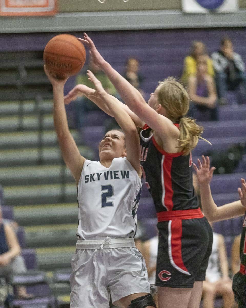 Faith Bergstrom (22) tries to block the shot of Skyview's Addison MacPherson during Tuesday's game. Bergstrom and the Camas defense was on point all night, holding Skyview to a season-low in points as Camas advanced to state. Photo by Mike Schultz