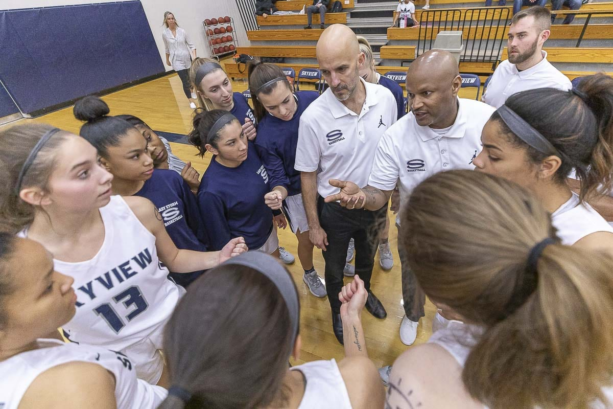 The Skyview Storm, coached by Brett Johnson, are the 4A GSHL girls basketball champions after beating Camas 56-51 on Monday. Photo by Mike Schultz
