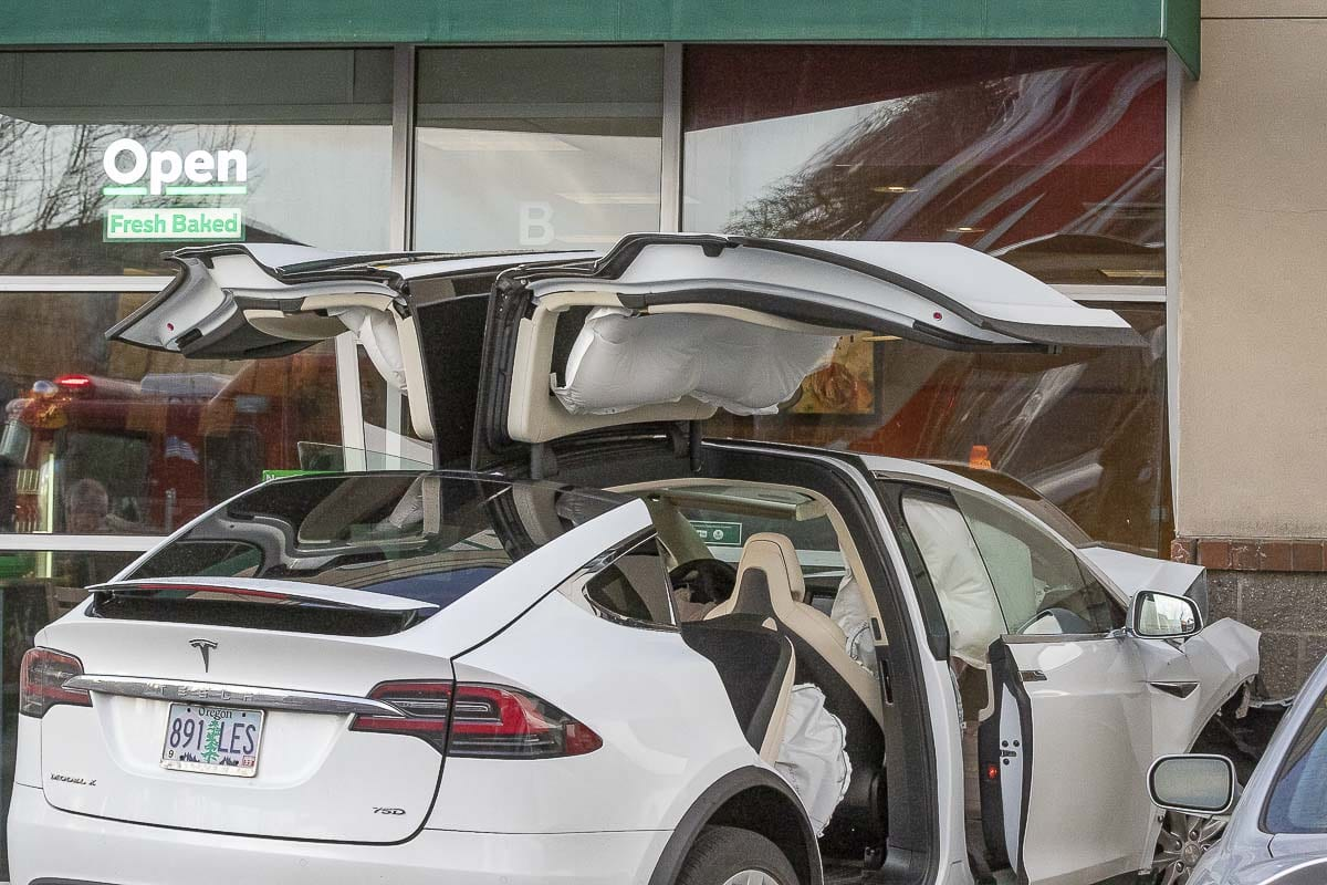 One passenger inside a Tesla that crashed into a Woodland Subway restaurant had minor injuries on Sunday afternoon. Photo by Mike Schultz
