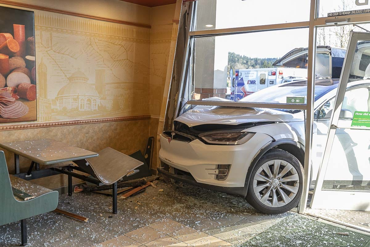 A Tesla plowed into the front window of a Subway restaurant in Woodland on Sunday. No one inside the restaurant was injured. Photo by Mike Schultz