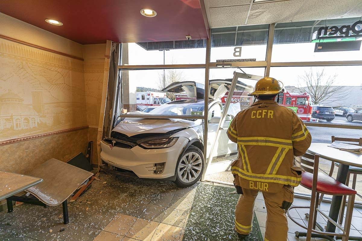 Customers say the angle this Tesla struck a Woodland Subway restaurant on Sunday likely prevented injuries to people inside the building. Photo by Mike Schultz