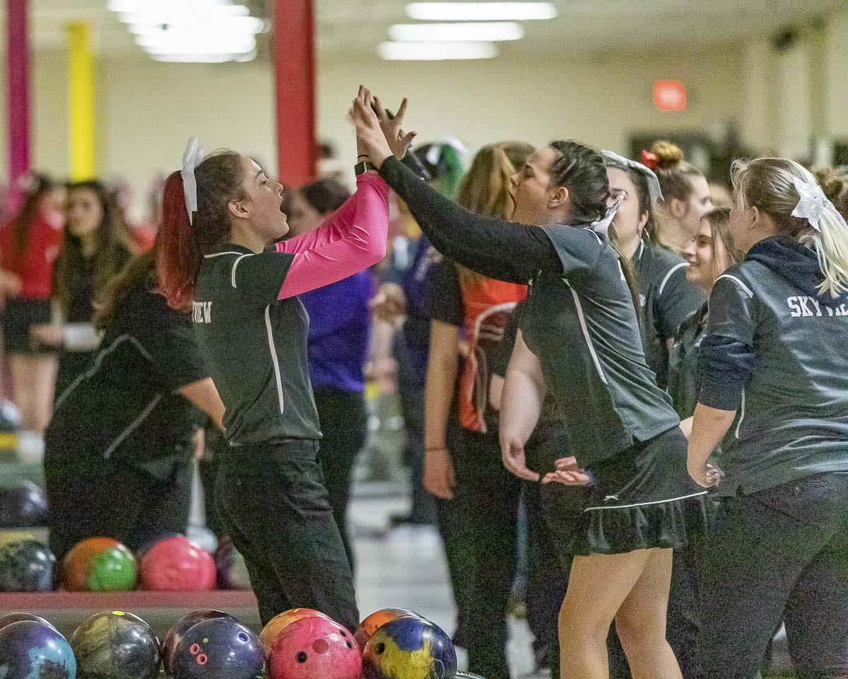 Skyview's Nicole Hayes (left) celebrates with a teammate during the district bowling tournament on Friday. Hayes won the 4A individual title and Skyview won the 4A team title. Photo by Mike Schultz